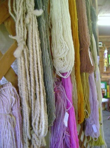 Hand dyed yarn drying on a rack. Pretty!