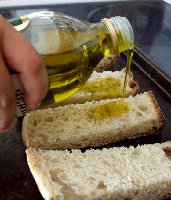 Golden liquid greedily soaked in by the bread